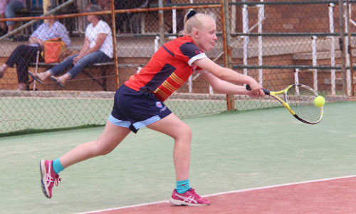 Caitlyn Ford stretches to play a backhand on Sunday at the 2018 Narrabri and District Tennis Association club championships.