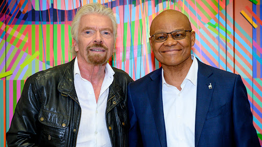 Sir Richard Branson, founder and chairman of Virgin Group, and Investec joint-CEO Fani Titi.