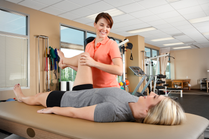 Physical therapist examining a patient's hip