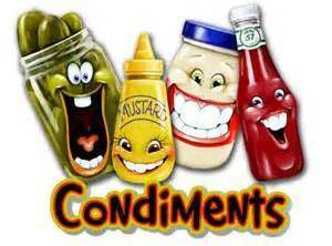 Condiments include...Sliced Tomatoes, Sliced Pickles, Shredded Cheese, and/or anything You like on your dogs...