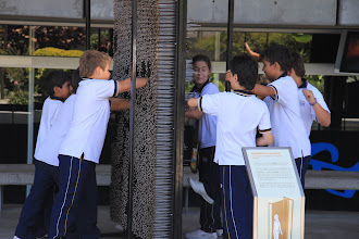 Photo: Students play with the giant pin sculpture