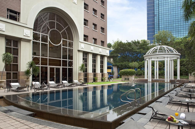 Pool side at Orchard Turn Suites
