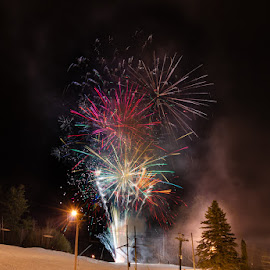 New Year's Fireworks At Cranmore Mountain III by Chris Cavallo - Public Holidays New Year's Eve ( ski, mountain, snow, tree, winter, long exposure, glow, lights, park, night photography )