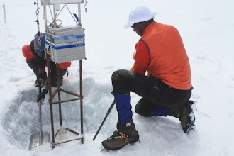 Photo: Resetting the UMass AWS on the Northern Ice Field