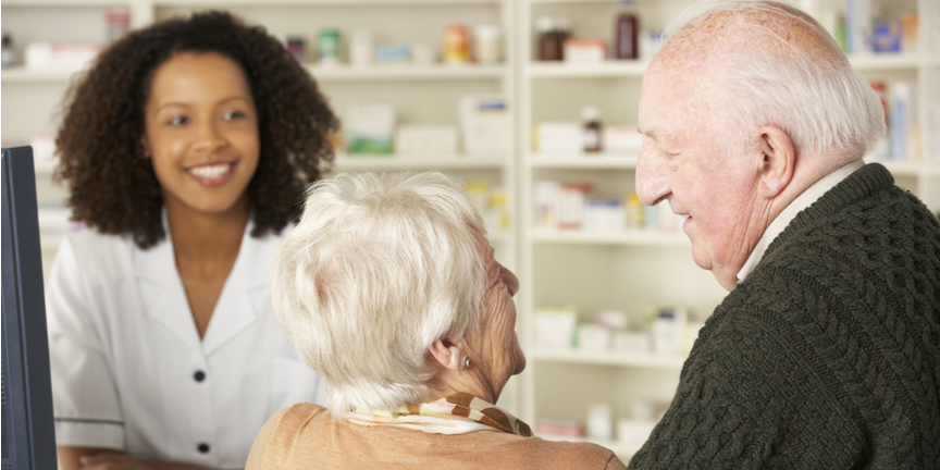 friendly-NHS-pharmacist-helps-old-couple