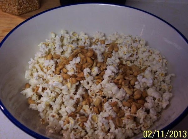 Pop the corn..put in a huge mixing bowl. Add the spanish peanuts.