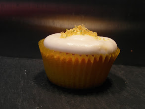 Photo: Lemon and lime cupcake topped with lemon and lime infused cream cheese icing topped with lemon and lime rind.