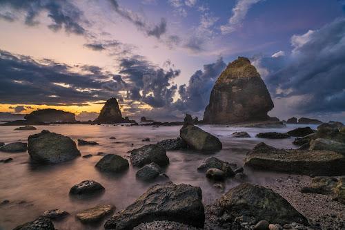 Stone at Tanjung Papuma Beach by Slamet Mardiyono - Landscapes Sunsets & Sunrises