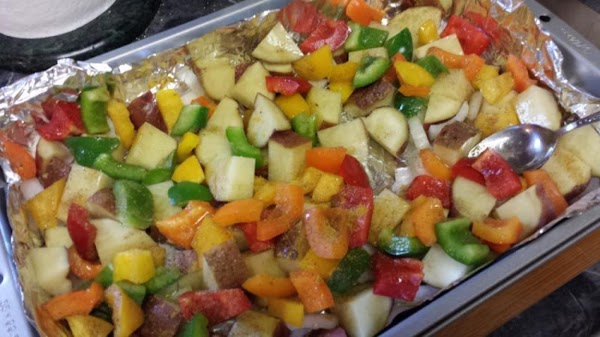 Arrange potatoes and vegetables in pan. Drizzle with olive oil and sprinkle with seasonings....