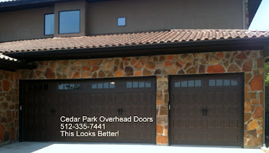 Photo: Cedar Park Overhead Doors. This is the Classica Raised Panel Door. Double steel with windows and decorative hardware. A more contempory look. A great looking insulated door with excellent durability.