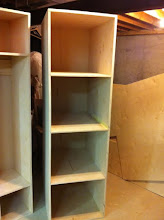 """Photo: The second of the two cabinets. It's designed to hold three laundry baskets. Each cubby is 28"""" deep."""