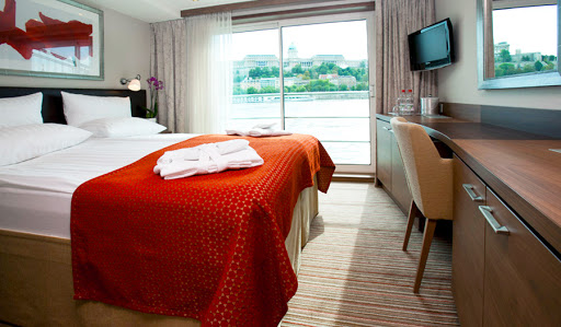 Avalon Luminary deluxe staterooms feature a well-stocked minibar and flat-screen satellite TV.