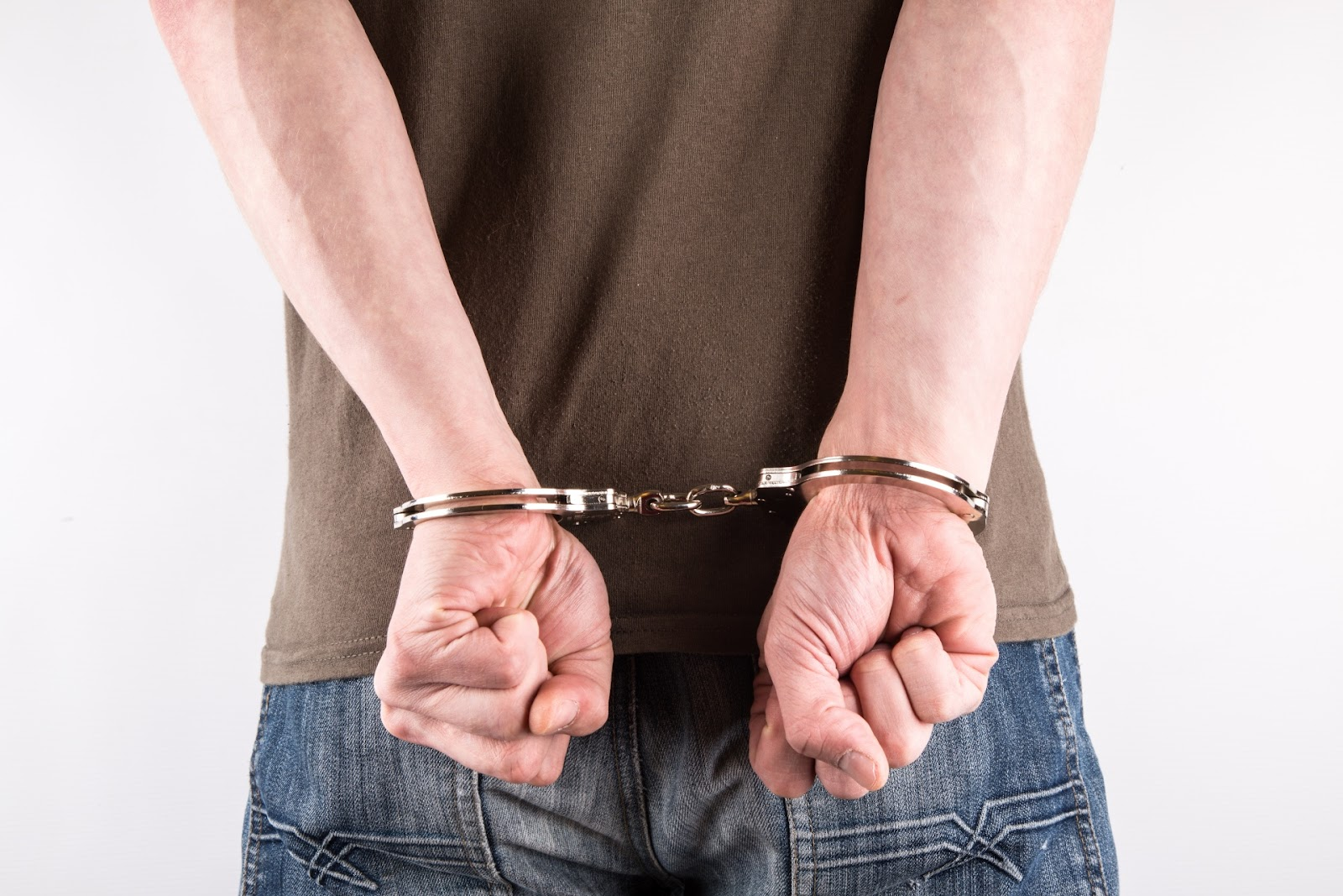 Hands In Handcuffs Free Stock Photo - Public Domain Pictures