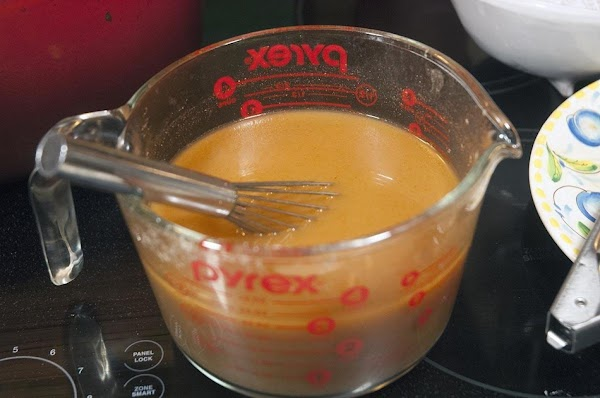 Add the cumin, paprika, cayenne, flour, and wine to the hot broth, and whisk...