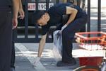 北京美使館外兩小時兩事件 女子企圖自焚男子擲爆炸物