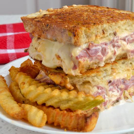 The Homemade Thousand Island Dressing Takes This Reuben Sandwich Over The Top.  Better Than Your Favorite Restaurant Reuben This Sandwich Hits The Sweet Spot Just Right.