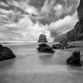 12 Apostles Shoreline by John Williams - Black & White Landscapes ( black & white, victoria, dramatic clouds, 12 apostles, rock formations, australia, long exposure, ocean shoreline, port campbell national park )