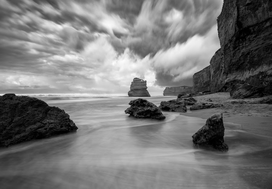 12 Apostles Shoreline by John Williams - Black & White Landscapes ( black & white, victoria, dramatic clouds, 12 apostles, rock formations, australia, long exposure, ocean shoreline, port campbell national park )