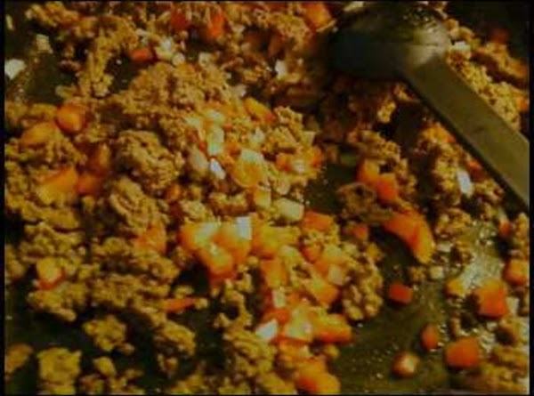In another skillet, add your oil and chopped carrots, grren peppers and potatoes, because...