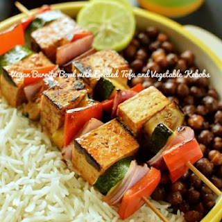 Vegan Burrito Bowl With Grilled Tofu And Vegetable Kebobs, Rice And Spicy Chickpeas.