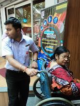 Photo: Saswati Acharia being wheeled into CCD Camac Street Kolkata during 2012 World Disability Day Celebrations.