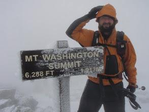 Photo: Tommy on the windswept summit of Mount Washington. Photo courtesy of Tommy Bell