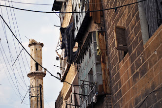 Photo: A badly damaged minaret of a mosque hit by government shelling. Since the outbreak of the Syrian war, mosques have been commonly targeted as a site where large groups gather for anti-government demonstrations. Aleppo, SYRIA - 11/4/ 2013. Credit: Ali Mustafa/SIPA Press
