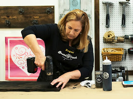 Woman using a power drill
