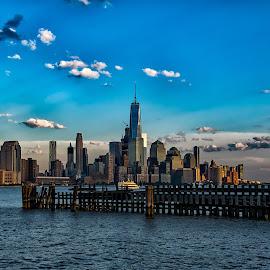 Manhattan Skyline at Dusk by Carol Ward - City,  Street & Park  Skylines ( manhattan skyline, pier a park, manhattan, hoboken, freedom tower, pier clouds, dusk, hudson river,  )