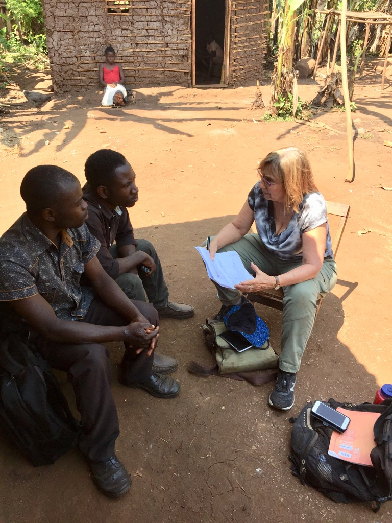 Robin conducting interviews with para-social workers in Kasese District, Uganda, July 2019.