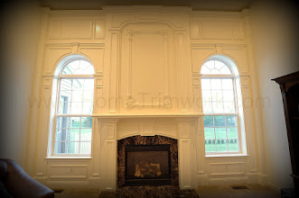 "Photo: (After) Phoenix's Family room:* New fireplace marble surround: ""Emperador Dark""* Mantle and overmantle* Side arched windows with pillars, and crown molding on topEaston, PA"