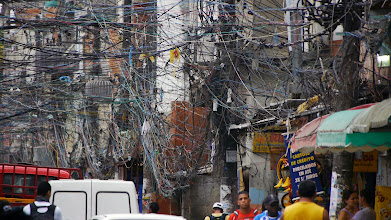Photo: Electric wires in a slum in Brazil in a scene from PANDORA'S PROMISE. Photo credit: Robert Stone.