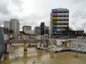 Photo: A fairly common sight in Chch -- the rain-filled remanants of a torn down building.