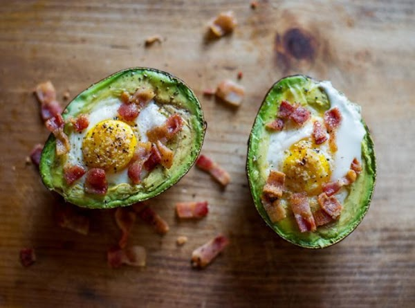 Sprinkle crumbled bacon on top. Spread the avocado/egg onto toast. Add addition salt and...