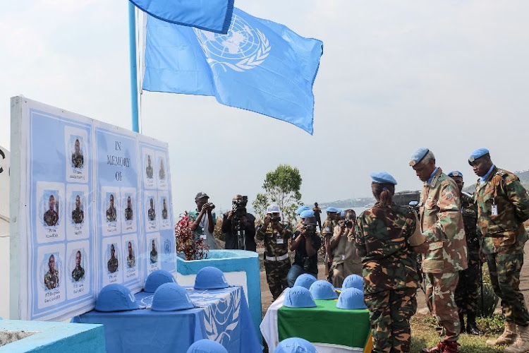Helmets of Tanzanian UN peace keepers who were killed by suspected Ugandan rebels are displayed during a tribute ceremony in Goma, on December 15, 2017.