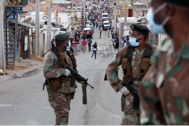 Members of the SANDF patrol the streets of Alexandra, Johannesburg, on the first day of the initial national 21-day shutdown.
