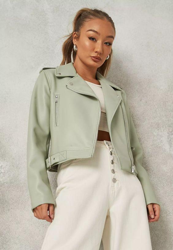 woman wearing a petite leather jacket