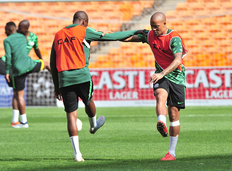 Bafana Bafana China-based striker Dino Ndlovu (R) takes part in training session at FNB Stadium in Soweto, south west of Johannesburg, on October 11 2018.