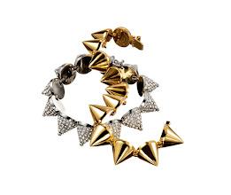 Photo: EDDIE BORGO Swarovski crystal pavé silver-plated brass cone bracelet. $1,000. 18k gold-plated brass cone bracelet, $600. USA. 5F. 212 872 8967