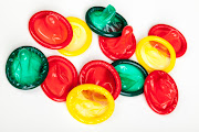red green yellow mixture of tasty condoms isolated on white background