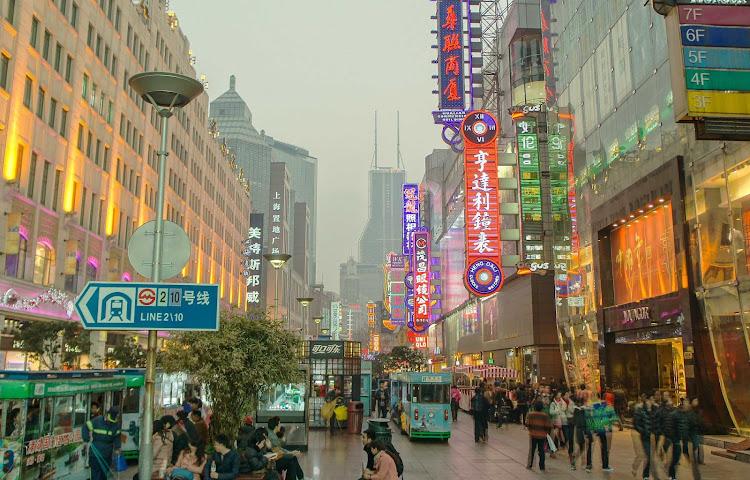 Pedestrians shopping along East Nanjing in the Huangpu District of Shanghai, China.