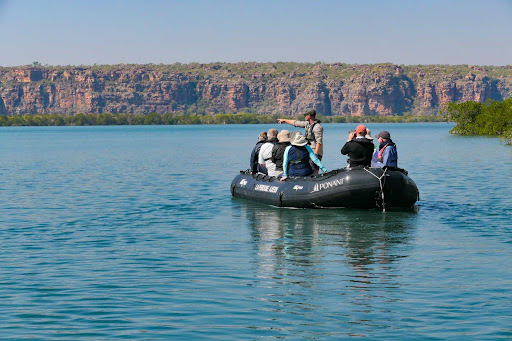 shore-excursion-kimberley.jpg - A guide steers guests to a shore excursion in the Kimberley region of Australia on a Ponant cruise.