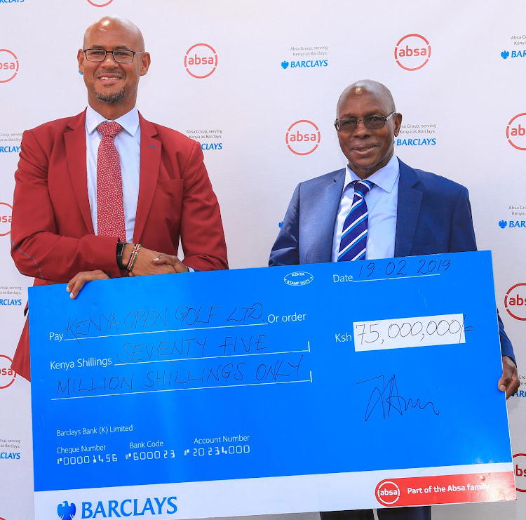 Kenya Open Golf Limited Chairman Peter Kanyago (R) receives a dummy cheque from Barclays Bank of Kenya Chief Executive Officer Jeremy Awori