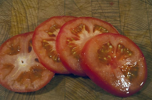Slice the tomato; you'll need four slices.
