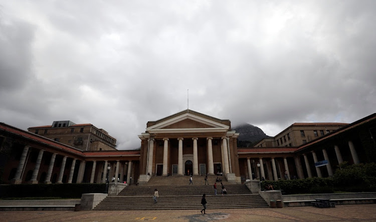 Students walk across a plaza in front of the University of Cape Town. File Photo.