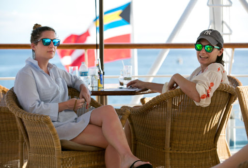 Passengers from New York on the bridge deck of Wind Surf on a Caribbean sailing.