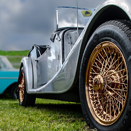 Still going stron by Roger Carlsson - Transportation Automobiles ( gold, car, silver, spokes, two )