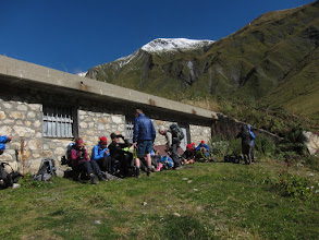 Photo: At Rifugio Elena (closed for the season) hikers shelter from the biting wind.