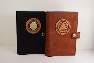 Photo: P0421 (left $49.95) Chrome Tanned Black color Suede leather Portable Paperback Big Book (Medallion Holder and Snap & Strap)   P0421 (right $39.95) Chrome Tanned Rust color Suede leather Portable Paperback Big Book (Circle/Triangle and Snap & Strap)