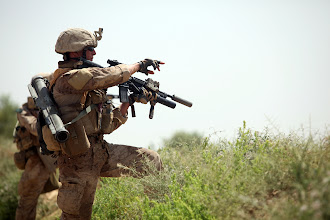 Photo: U.S. Marine Cpl. Kristopher Gates, with 3rd platoon Company B, 1st Reconnaissance Battalion, points out the direction of the enemy fire during a firefight in Northern Trek Nawa, Afghanistan, Aug. 15. The Marines and sailors of Company B are currently conducting counter insurgency operations in support of the International Security Assistance Force.